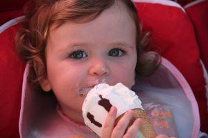 girl in pink shirt eating ice cream